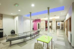 L'espace d'accueil - vue vers la laverie et les sanitaires